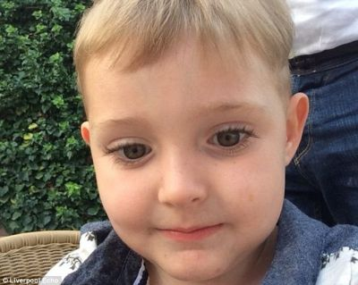 Boy, 4, has ear sewn back on after dog savages him PHOTO