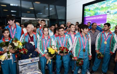 Azerbaijani Olympic athletes return home PHOTO