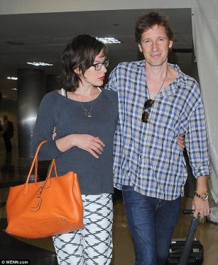Pregnant Milla Jovovich strolls arm-in-arm with husband  PHOTO