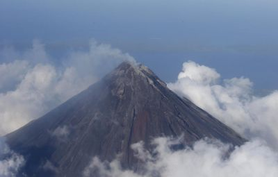 Lava flows from Philippine volcano; thousands flee