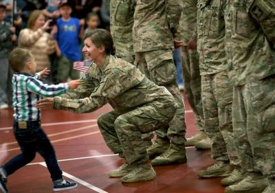 Hugging mom toddler ignores military protocol