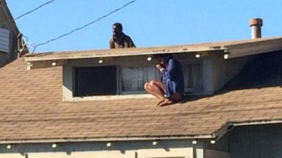 Woman hides on house roof to escape intruder PHOTO