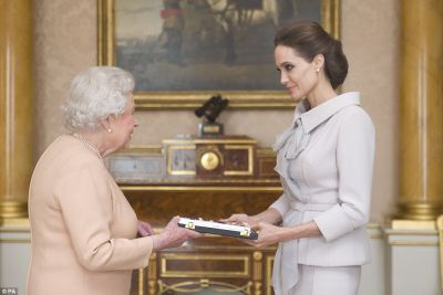 Jolie receives damehood from the Queen PHOTO