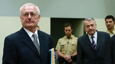 2 top former Yugoslav agents go on trial in Germany