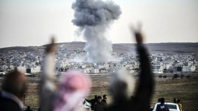 US-led air strikes in Syria 'kill 553 in first month'