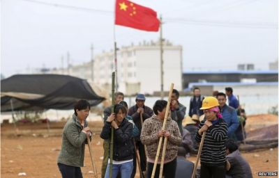 China punishes 17 officials after deadly village clash