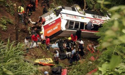 Bus drives off Nepal mountain road, 9 killed