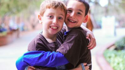 Boy raises nearly $1M with self-published book for friend with rare disease
