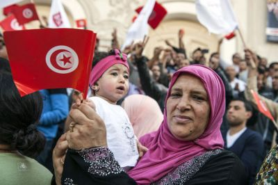 Arab spring alive in Tunisia as power transfers peacefully
