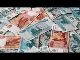 Belarus cuts official currency rate to defend against Russian pain