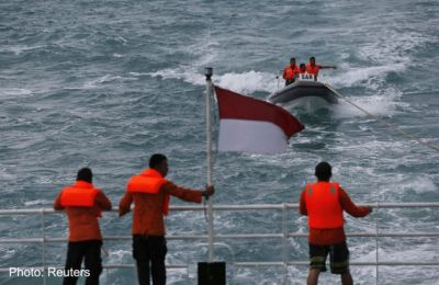 Indonesia says crashed AirAsia plane tail found