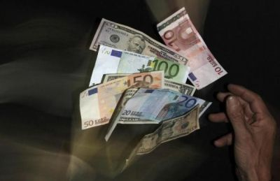 Euro sinks to nine-year low