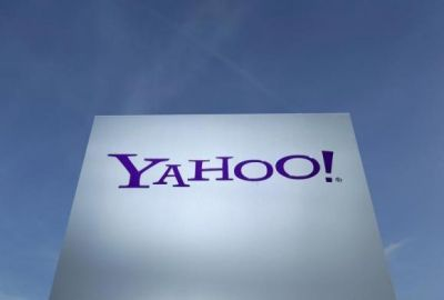 Yahoo sets Alibaba stake spinoff plan, shares jump