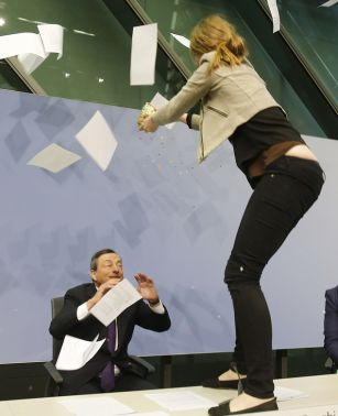Woman throws paper at the ECB President  PHOTO