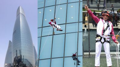 Baku 2015 Torch descends Flame Towers in spectacular abseil