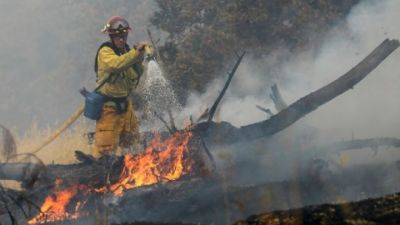 California wildfires: firefighter killed