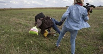 TV camerawoman fired for tripping Syrian migrants