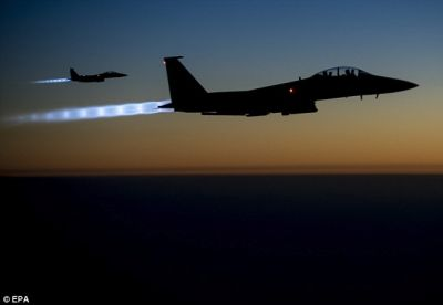 US leads 21 air strikes against IS in Syria, Iraq