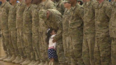 Little girl runs to hug soldier dad