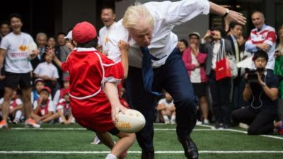 London Mayor knocks child to ground in touch rugby PHOTOS