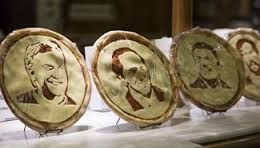Pizzas with faces of presidential candidates shown in Buenos Aires