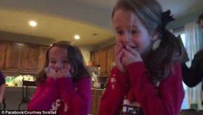 Kids surprised with adopted baby under Christmas tree