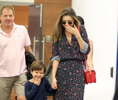 Miranda Kerr returns to Australia with her son