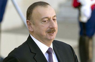 Ильхам Алиев принял участие в церемонии сдачи жилого здания, построенного для военнослужащих