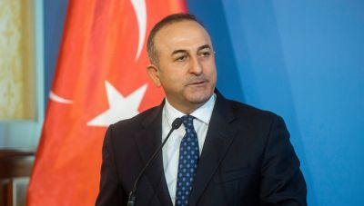 Глава МИД Турции обвинил Германию в поддержке РПК и сторонников Гюлена