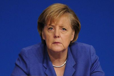 Канцлер ФРГ: Oколо 60 тысяч мигрантов должны покинуть Германию
