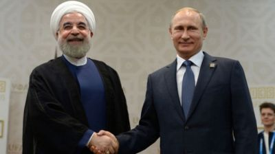 Putinlə Həsən Ruhani Trampın siyasətini müzakirə edəcəklər