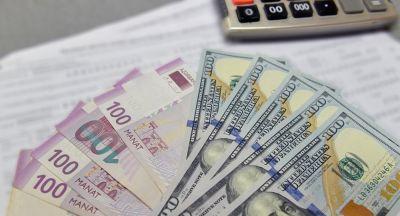1 dollar 1,7023 manat